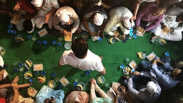 Friends, neighbours and well wishers join Ankit Saxena's family for Iftar.