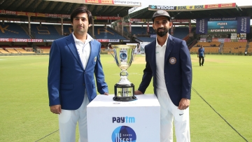 Indian captain Ajinkya Rahane and Afghanistan captain Asghar Stanikzai during day one of the Test match between India and Afghanistan held at the M Chinnaswamy Stadium in Bengaluru on Thursday,  14 June.