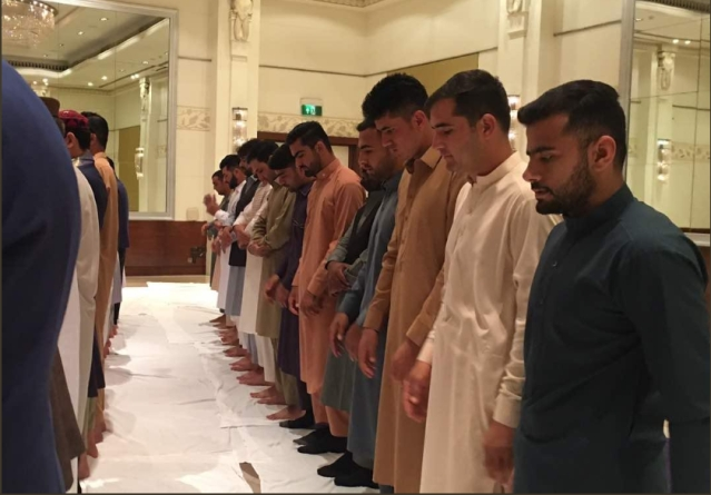 Afghanistan cricketers celebrate Eid before leaving for the stadium on 15 June.