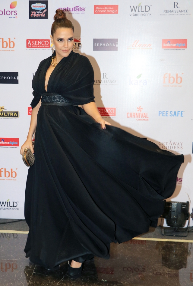 Neha Dhupia was twirling her gorgeous black dress.