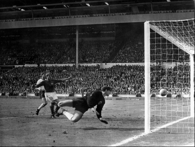 In this July 30, 1966 file photo, a shot from Geoff Hurst bounces down from the West Germany crossbar during the World Cup final at London's Wembley Stadium. The linesman gave it as a goal and England went to to win 4-2.