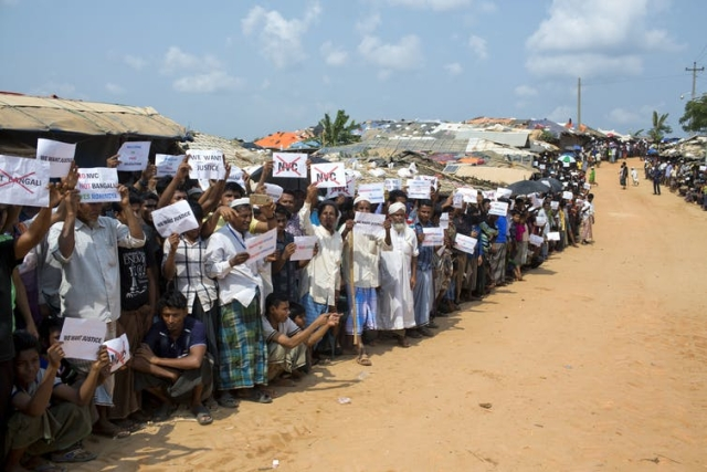 Rohingya refugees holding placards, await the arrival of a UN Security Council team in Bangladesh.
