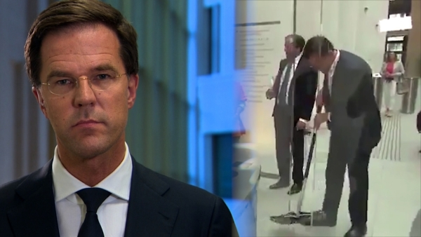 Prime Minister of The Netherlands Mark Rutte spilt coffee in a lobby of Dutch Parliament building.