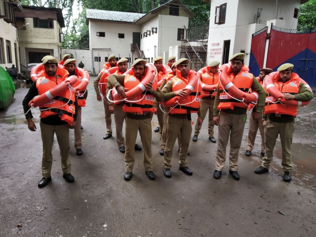 Police personnel equipped to handle any untoward situations that might arise due to the rains.
