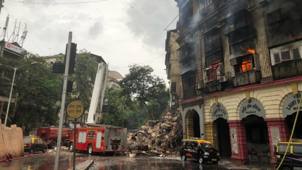 Firefighters extinguish a blaze that caused Kothari building in Mumbai to partially collapse.