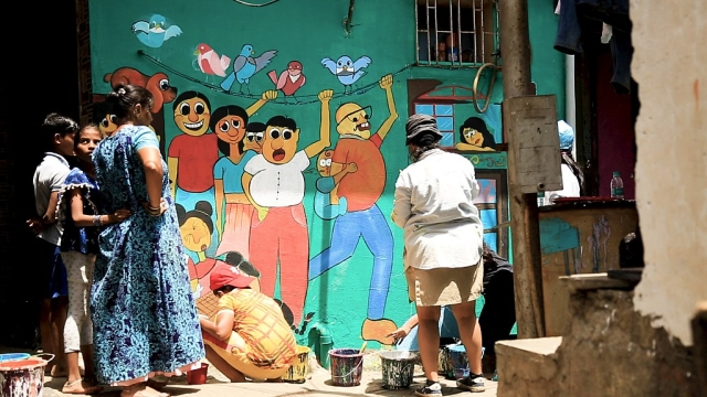 52 artists were invited to create murals on the walls of Khar Danda