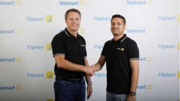 Walmart CEO Doug McMillon with Flipkart Co-Founder and CEO Binny Bansal.