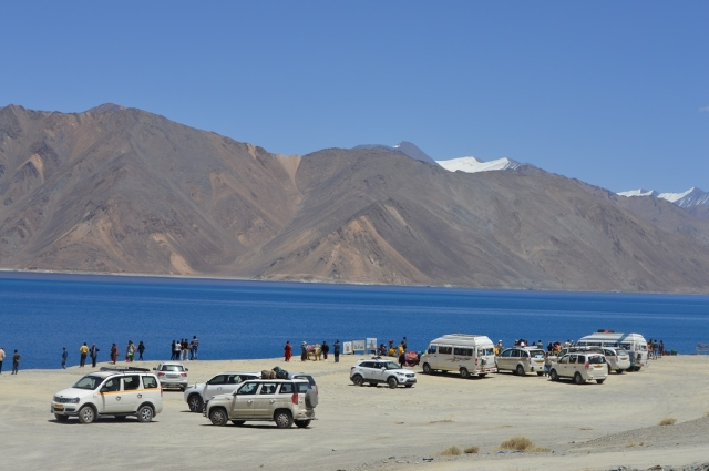 According to Leh officials over 600 vehicles go to Pangong Lake every day. Many of these vehicles go right up to the lake shore, although a sign cautions tourists that this is forbidden.