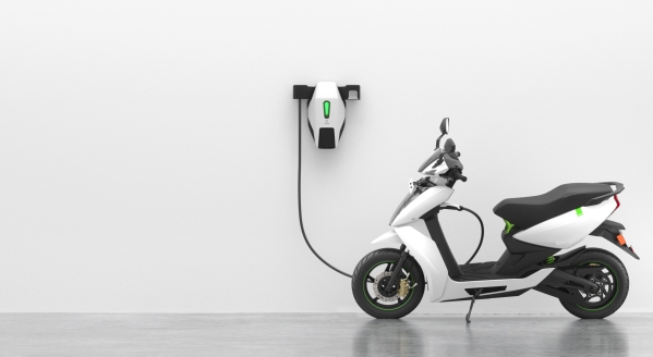 The Ather 450 electric scooter getting charged.