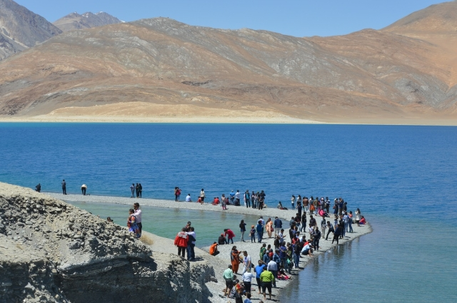 Pangong Lake, with its shimmering blue waters, spreads over 125 kilometres and has become immensely popular with Indian tourists since Bollywood movies <em>3 Idiots</em> and <em>Jab Tak hai Jan</em> were filmed in and around the lake in 2009 and 2012.