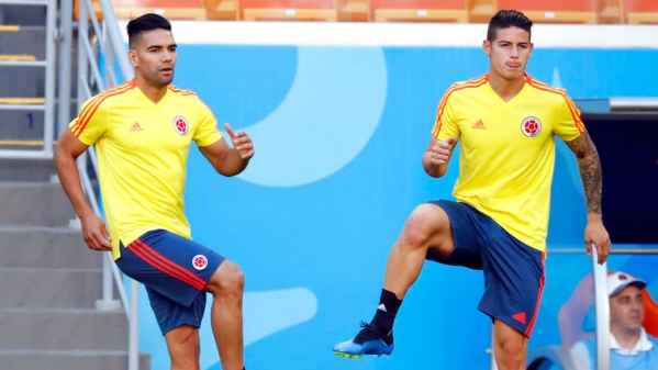 Colombia's James Rodriguez, right, and Radamel Falcao, left, warm up during a practice session.