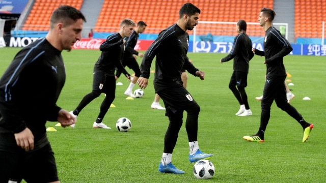Uruguay's Luis Suarez (centre) dribbles the ball during Uruguay's official training on the eve of the group A match between Egypt and Uruguay at the 2018 FIFA World Cup.