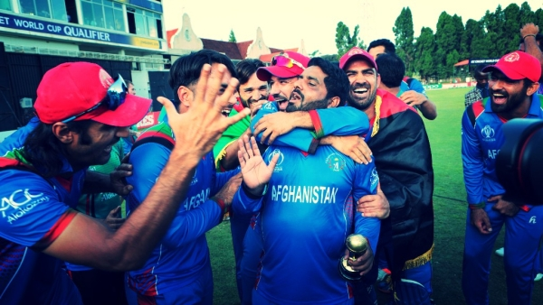 Afghanistan players celebrate after beating Ireland to qualify for the 2019 Cricket World Cup.