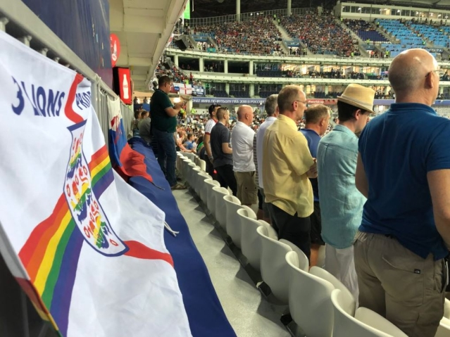 English LGBT football fans unfurled a rainbow England flag during their first World Cup match against Tunisia.
