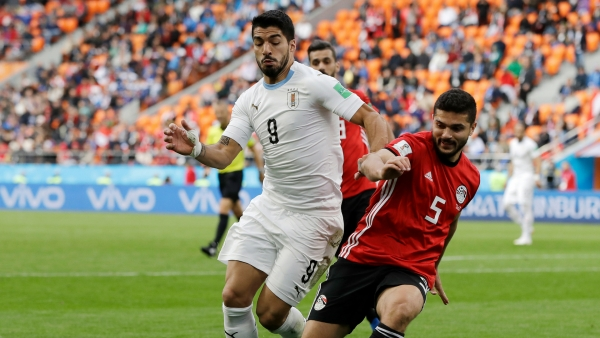 Uruguay's Luis Suarez,  challenges for the ball with Egypt's Sam Morsy during the group A match between Egypt and Uruguay at the 2018 FIFA World Cup.