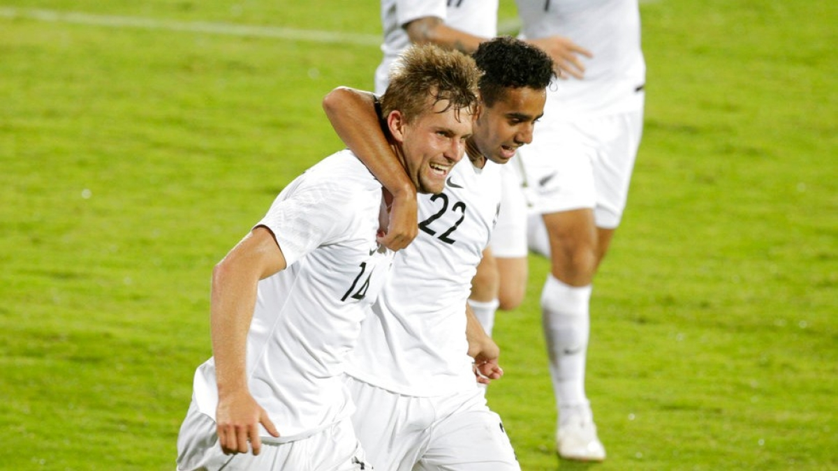 New Zealand's Andre Ernest De Jong, left, celebrates with teammates after scoring a goal.