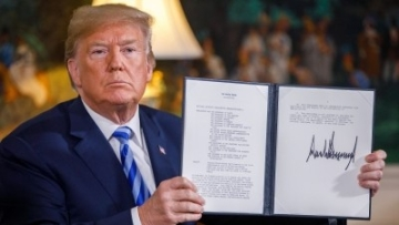 US President Donald Trump displays a signed presidential memorandum at the White House in Washington DC, the United States, on 8 May.