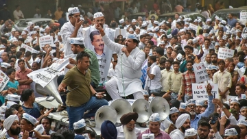 AAP leader Sanjay Singh with party leaders and workers during a protest as they marched towards the Lt Governor's residence, in New Delhi on Wednesday, June 13, 2018