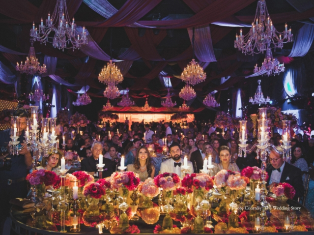 The decor was complete with gorgeous floral arrangements, exquisite drapes and a large stage with an LED backdrop displaying the couple's initials monogrammed.