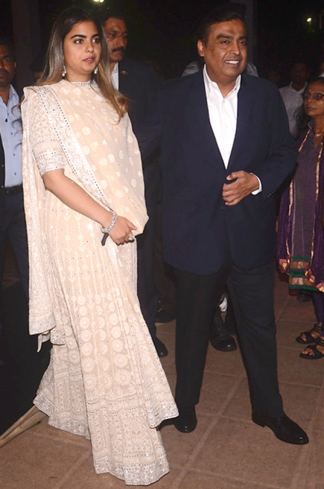 Isha Ambani poses with father, Mukesh Ambani.