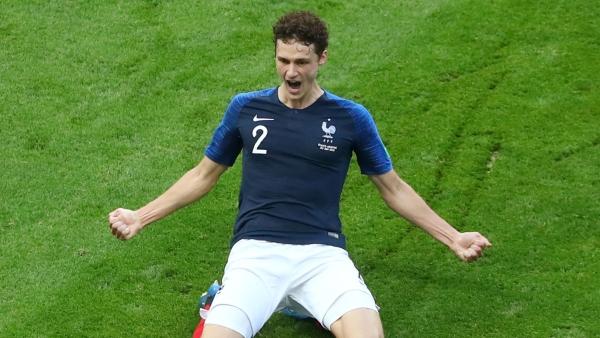 Benjamin Pavard celebrates scoring France's second goal against Argentina.