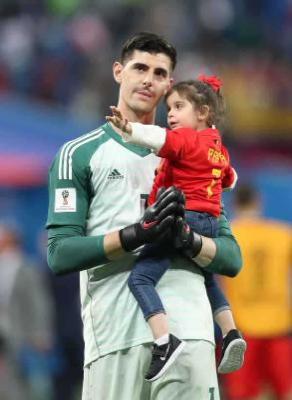 SAINT PETERSBURG, July 10, 2018 (Xinhua) -- Goalkeeper Thibaut Courtois of Belgium and his daughter are seen after the 2018 FIFA World Cup semi-final match between France and Belgium in Saint Petersburg, Russia, July 10, 2018. France won 1-0 and advanced to the final. (Xinhua/Fei Maohua/IANS)