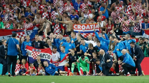 Croatia team celebrates at the end of the semifinal match between Croatia and England at the 2018 FIFA World Cup in the Luzhniki Stadium in Moscow, Russia, Wednesday, July 11, 2018.