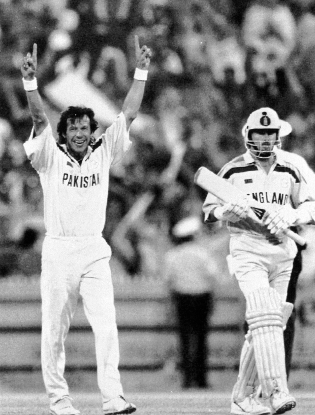 Pakistan captain Imran Khan (left) raises his arms in triumph, as England's last batsman Richard Illingworth (right) walks away after being given out during the World Cup Cricket Final, in Melbourne, Australia.