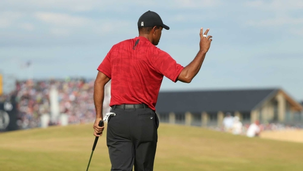 Tiger Woods of the US plays a shot to the 18th green during the final round for the 147th British Open Golf championships in Carnoustie, Scotland, Sunday, July 22, 2018.