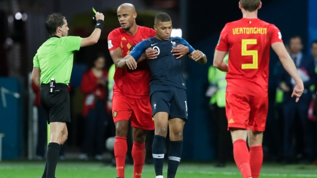 Mbappe was shown a yellow card for time-wasting tactics against Belgium.