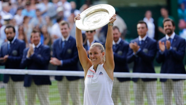 Angelique Kerber celebrates with the Venus Rosewater Dish after defeating Serena Williams in the Wimbledon final.