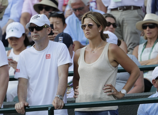 Mirka Federer, wife of, Switzerland's Roger Federer watches from the stands after he lost his men's quarterfinals match against Kevin Anderson of South Africa, at the Wimbledon Tennis Championships.