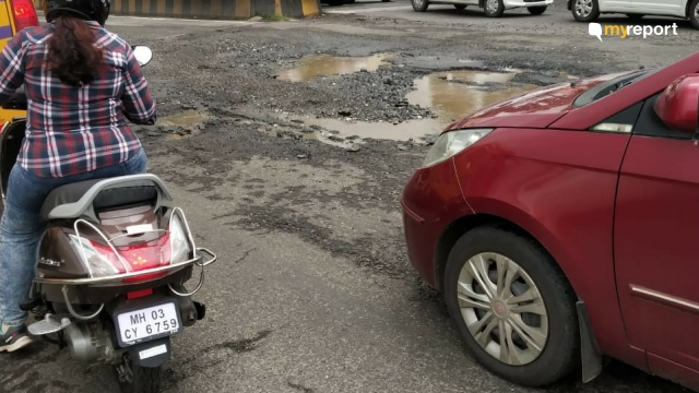 Roads damaged by potholes during monsoon season at  Airoli, Navi Mumbai.