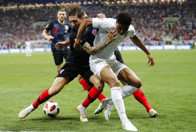 England's Marcus Rashford, right, and Croatia's Sime Vrsaljko challenge for the ball.