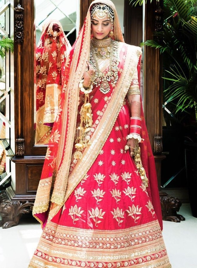 Sonam surprised the world by choosing to wear a traditional red and gold <i>lehenga</i> by the Anuradha Vakil.