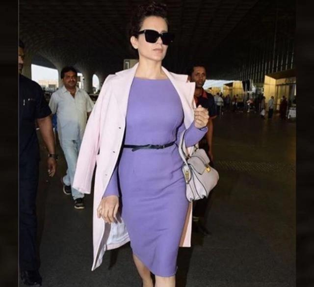 Kangana Ranaut was spotted at the Mumbai International airport wearing a sleek knee length lavender Dior dress and a pale pink Prada coat.