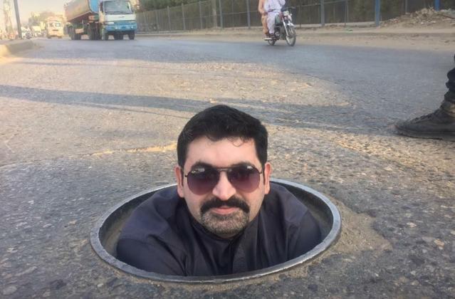 Motiwala poses in a sewage pipe.
