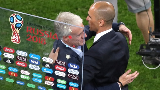 French coach Didier Deschamps (left) and Belgium's coach Roberto Martinez after their semi-final match on Tuesday.