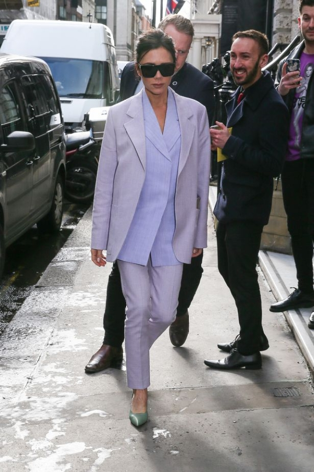 Vicktoria Beckham arrives at her store wearing a lilac 'mans' jacket and slim trousers.