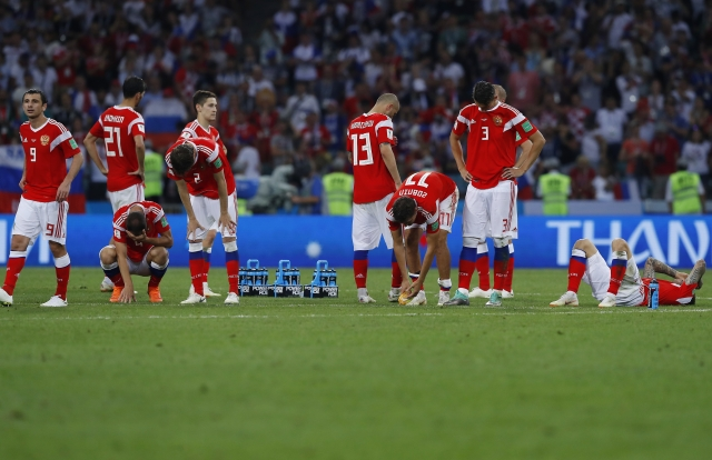 Russia national soccer team players react at the end of the quarter-final match between Russia and Croatia.