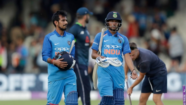 India's Yuzvendra Chahal, left, and India's Kuldeep Yadav walk off the field of play at the end of the one day cricket match between England and India at Lord's cricket ground in London.