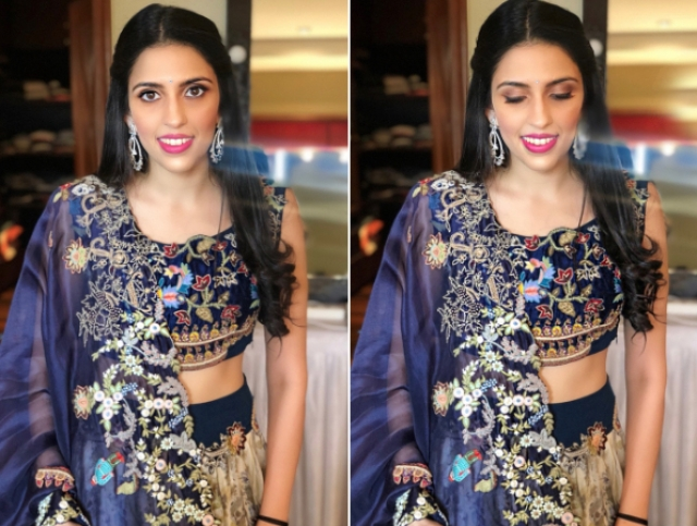For the pre pre-engagemet bash, the bride-to-be opted for an Anamika Khanna navy blue and cream lehenga laced with heavy embroidery. She rounded off her look with diamond earrings, centre-parted hair and pink lips.