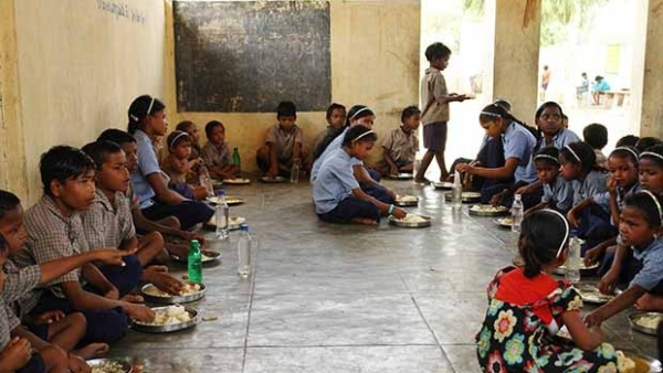 Students having their Mid-Day Meal in school