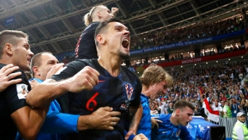 Croatia's Dejan Lovren celebrates after Mario Mandzukic scored his side's second goal against England.