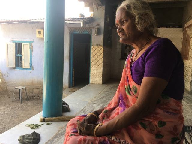 Mother of a diamond worker Kunwarben sits on a cot in her village Liliya, Gujarat, India, January 31, 2018.