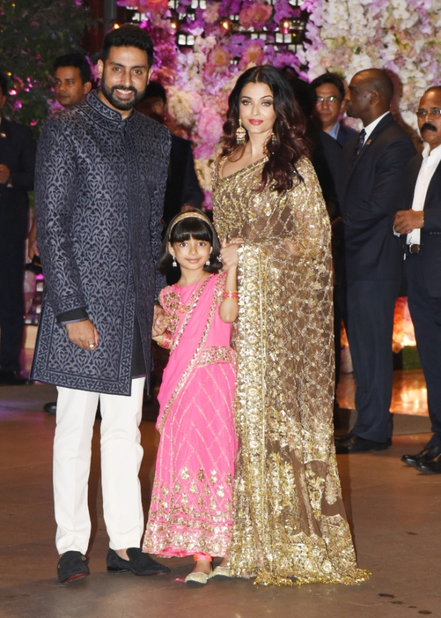 Abhishek Bachchan with daughter Aaradhya and Aishwarya Rai Bachchan at the party.