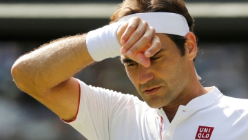 Roger Federer wipes his forehead during the fifth set of the Wimbledon quarter-final against Kevin Anderson.