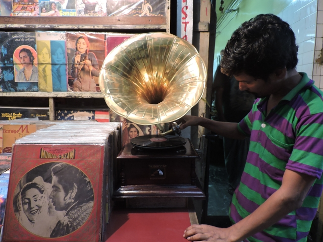 A shopkeeping assistant, Nandu, operates the gramophone.