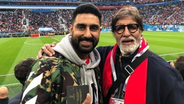 Abhishek and Amitabh Bachchan at the France-Belgium World Cup semi-final match.