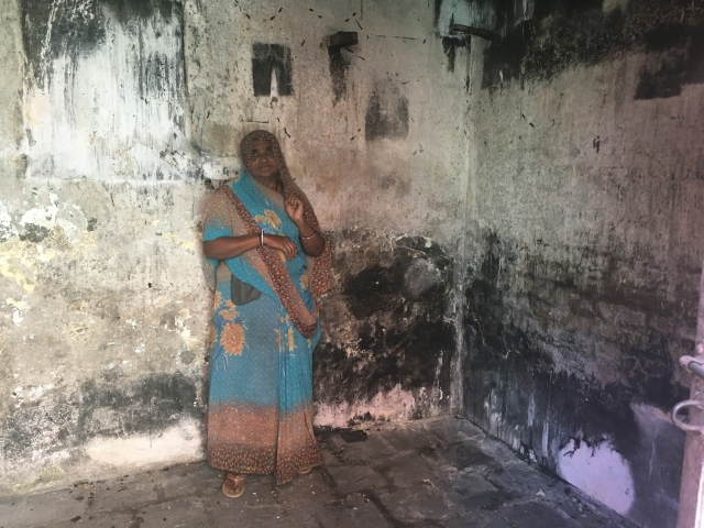 Wasanben stands inside the house where her diamond polisher son set himself on fire in Bhavnagar, India, 30 January 2018.